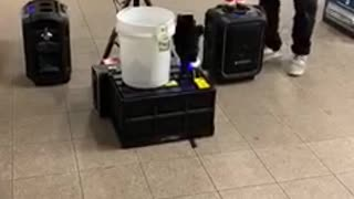 Man playing saxophone with dolls dancing to music