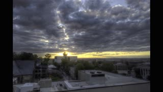 RAW version of HDR Time-lapse video of sunset over cityscape