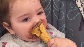 Baby makes adorable mess eating ice cream