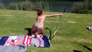 South African Girl Catches A Speedy Cobra while sunbathing