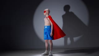 A Child Looking at a Camera while in a Super Hero Costume