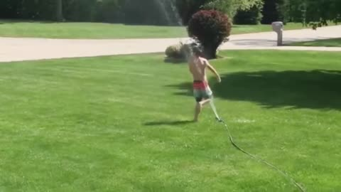 watch funny baby playing with water