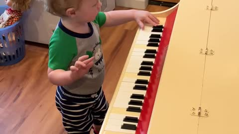 Piano playing Great Grandson