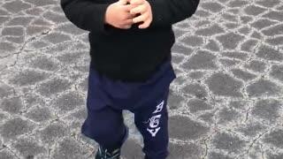 Little Asian boy walking.
