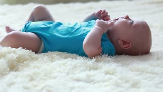 little boy flips on his stomach
