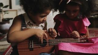 cute kids playing guitar