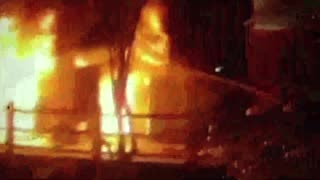 Moment Burning Building Facade Collapses On Firemen