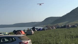 water plane flies over the reservoir