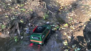 Green RC Car in Water and Mud