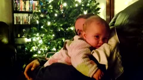 Adorable baby struggles to stay awake