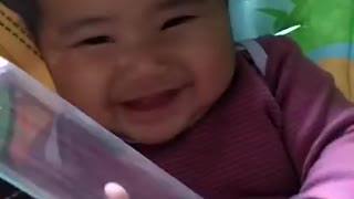 Baby hilarious laughing over the balloon