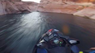 Jet Ski Racer Rides through Canyons