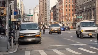 Dude Walks In The Middle of NYC Street as Cars Almost Hit Him
