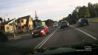 Motorcyclist Has Near Miss with Truck