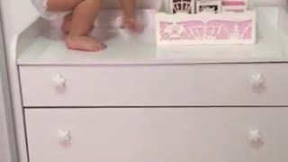Girl Finds a Way to Climb onto Dresser