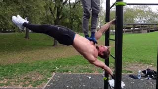 """Man shows off insane strength while demonstrating the """"human flag"""""""