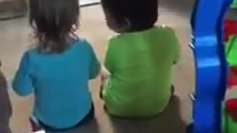 Little girl preciously consoles her twin brother