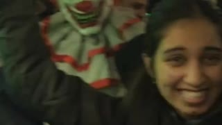 Person subway train packed scary clown costume