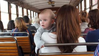 Baby enjoying his first train ride With his parents