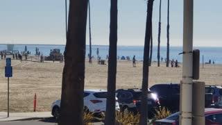 Military flying coast off Long Beach
