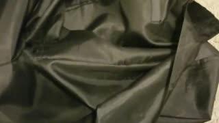 Orange white cat hiding inside of black duffle bag