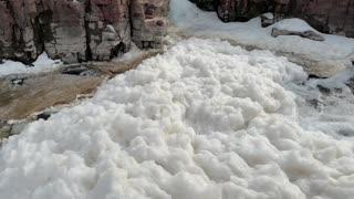 Massive amounts of foam buildup in Big Sioux River