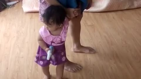 Eldest daughter walking like her Mommy