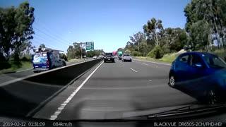 White SUV Flips Over onto Vehicle on Freeway