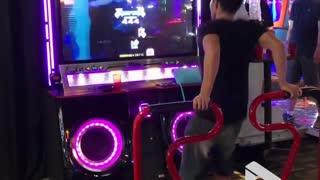 Guy nails foot dancing arcade game
