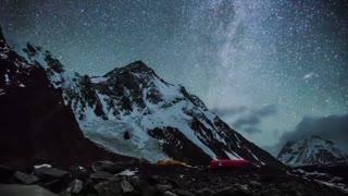 Mountain timelapse video of night sky.