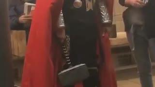 Man dressed as thor on subway station