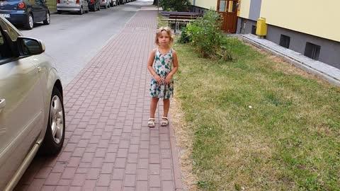 Little Girl Demonstrating How Penguins Run