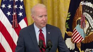 Creepy Joe Biden whispering