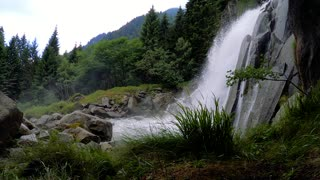 waterfall from the mountain with green forest