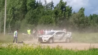Car Flies After Hitting A Bump In The Road, Barely Misses Cameraman