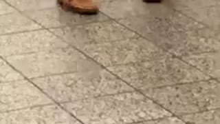Old man white shirt dancing subway station