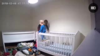 Boy Helps Brother out of Crib