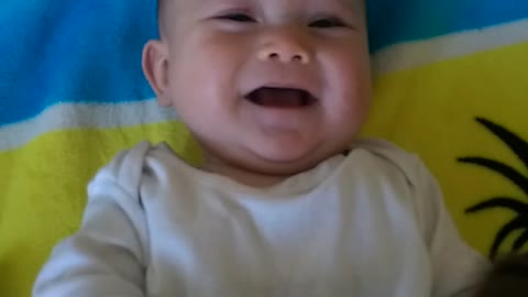 Little girl laughs with her mommy