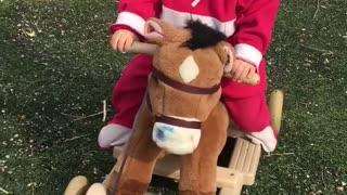 Little rider saddled pony