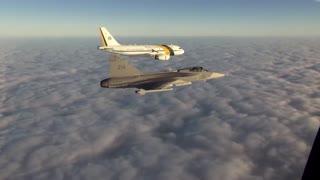 Brazilian Presidential plane welcomes a Gripen fighter