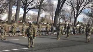 Majority of the military turning their backs on Biden as the Biden motorcade drove by.