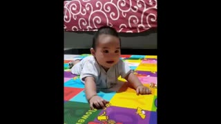 Happy baby's laughter is extremely contagious