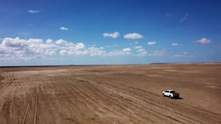 A Pickup Truck Is Travelling On A Desert