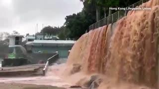 """Black rainstorm"" floods Hong Kong roads"