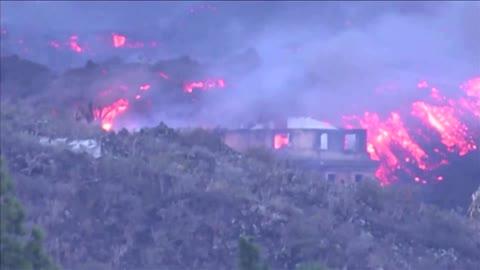 Buildings burn as La Palma volcano eruption continues