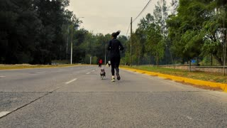 A runner walking with her dog