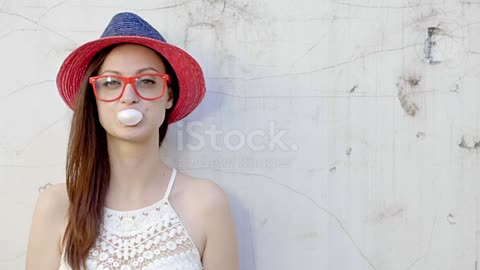 Trendy fashionable girl blows big bubble from bubble gum stock video