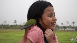 A girl with a parrot!