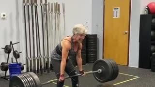 Elderly Woman Deadlifts Heavy Weights