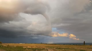 Massive waterspout over lake resembles tornado